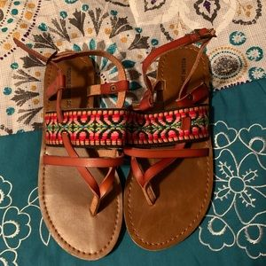Women's sandals buckle around the ankle.